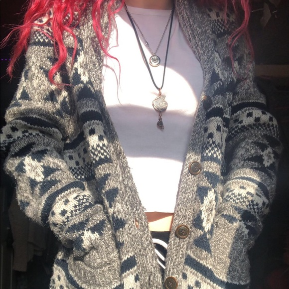 Blue, white, and gray sweater.